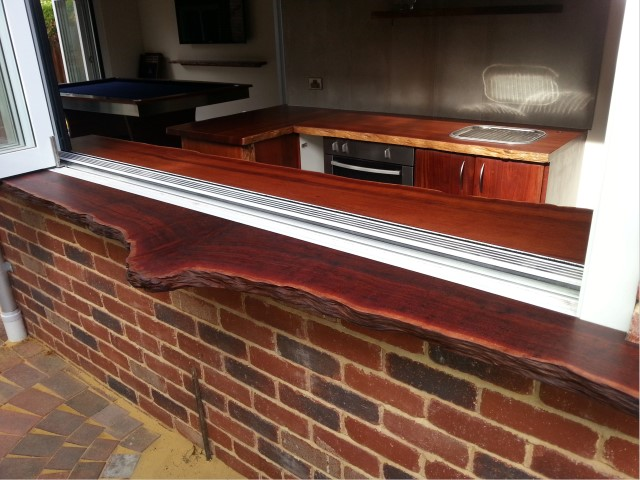 Exterior jarrah servery with natural edges, finished in tung oil