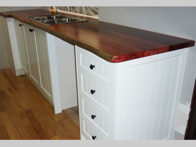 Jarrah kitchen bench tops on white cupboards