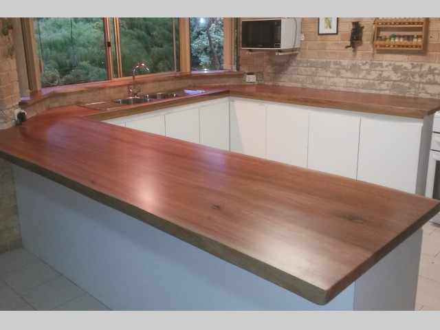 U-shaped jarrah kitchen bench tops with natural edges